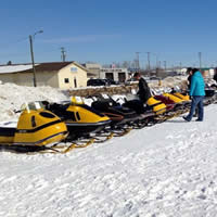 A row of vintage sleds are lined up at Elk Point's annual Vintage Snowmobile Rally.