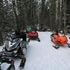Photo of a parked snowmobiles