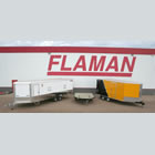 Photo of Flaman trailers parked in snow