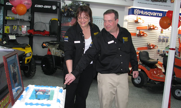 Brother and sister team, Steve and Wendy Grandbois, at the grand opening of Nickel City Motor's new location in 2010.