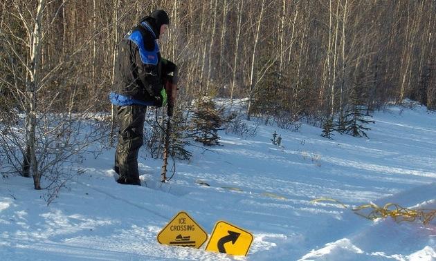 Watt Mountain Wanderers snowmobile club President, Barry Toker working on signage.