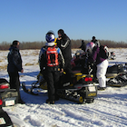 People and snowmobiles