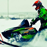 A snowmobiler out on a ride.