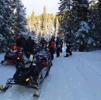 A number of sledders stopped on one of the Sno-Seekers' many mapped, wide, groomed trails in Edson, Alberta and the surrounding area.