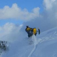 A snowmobiler cresting a hill near Mackenzie.