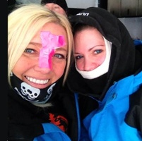 Stephanie Schwartz and Darcie Downy with duct tape on their faces to fend off the cold.