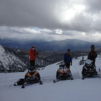 4 snowmobilers on a ridge in the Babcock riding area.