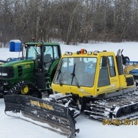 A photo of 3 tractor groomers used by the Yorkton SnoRiders.