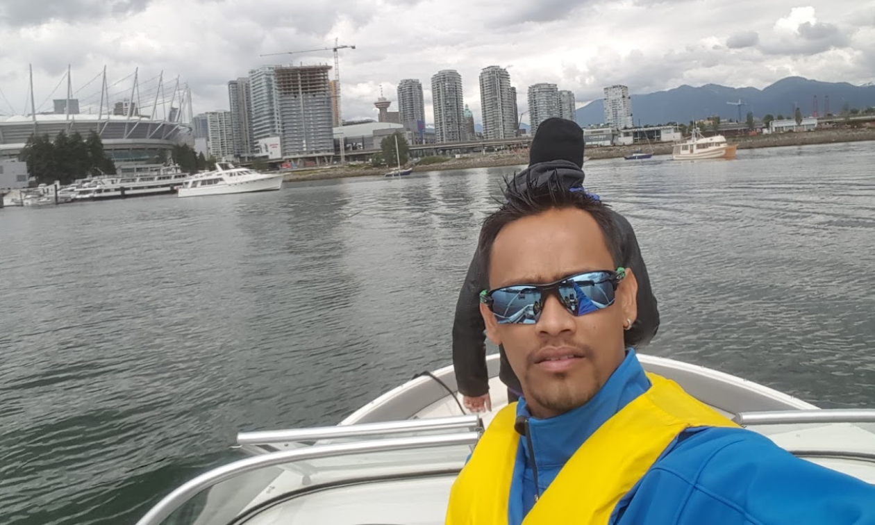 The Vancouver shoreline is behind Melvin Garib as he rides his 2015 Bayliner 190 OB Bowrider.