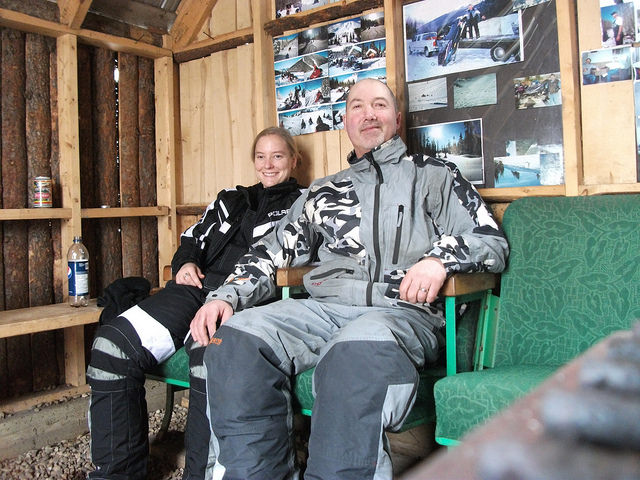 Darren and Baukje Strawson, in a cabin warming up.