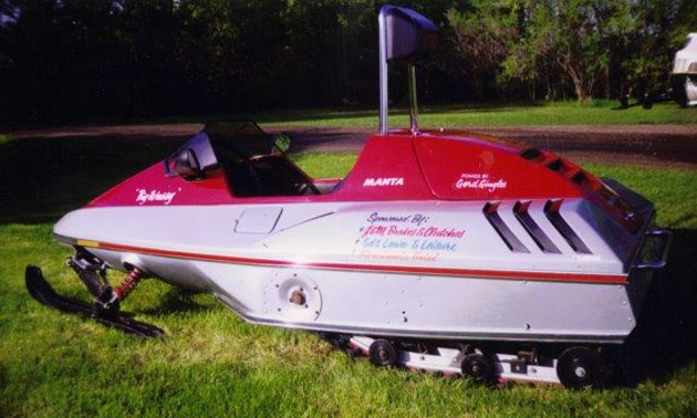 1985 Manta sled, red and white in colour.