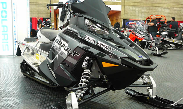 A black Polaris snowmobile.