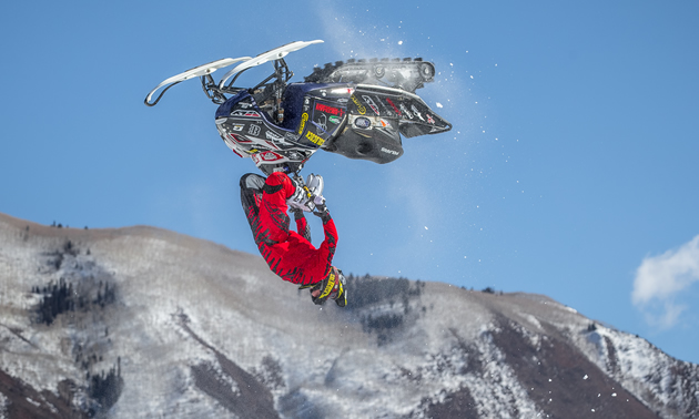 Sam Rogers backflipping a snowmobile.