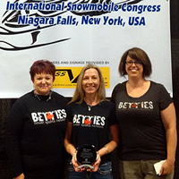 Donegal Wilson and two other ladies from the Betties Power Sports Network accepting an award.