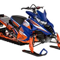 Yamaha orange and blue mountain sled.