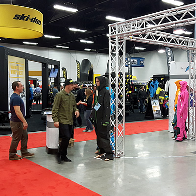 Showgoers walking the red carpet at the Edmonton Snow Show.