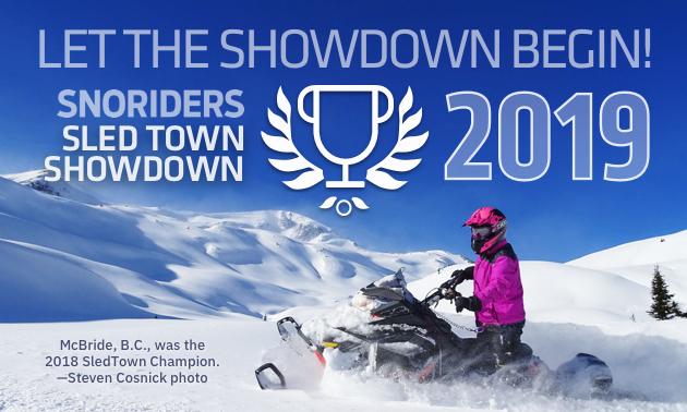 A woman rides a snowmobile through McBride, B.C.