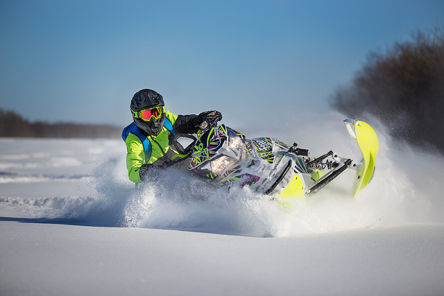 Michael Fidek riding through powder