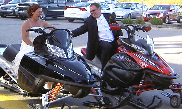 A couple getting married on sleds.