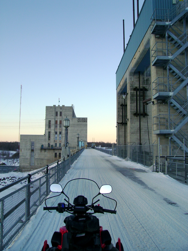 Crossing the Seven Sisters hydro dam at Whiteshell Provincial Park.