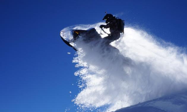 Cody Lumax taking a jump on his sled.