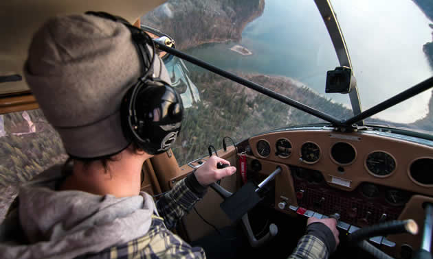 Dave England flying his plane.