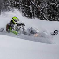 Dave Norona shredding through the snow.