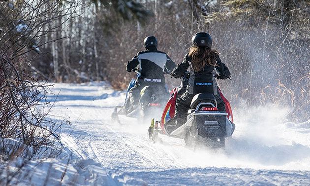 New snowmobile riders on the trail.