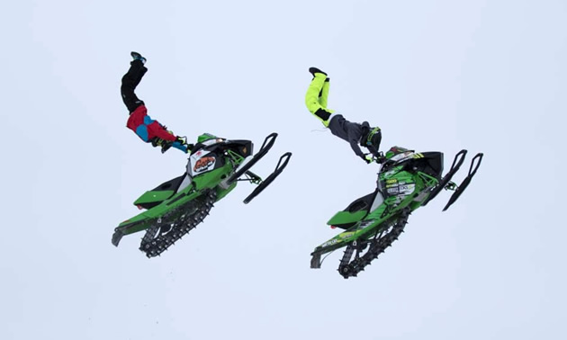 Josh Penner and Brett Turcotte in the air at the Penner Compound.
