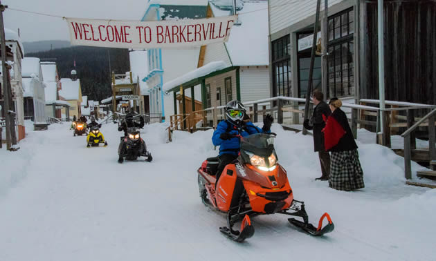 Snowmobiling through Barkerville.