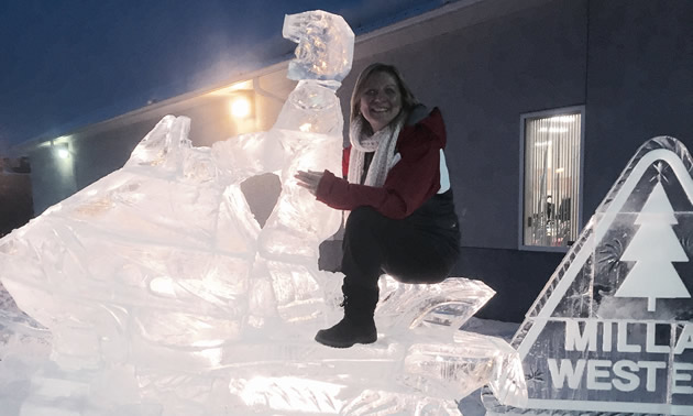 Maryann Chichak on a snowmobile ice sculpture during the sled invasion.
