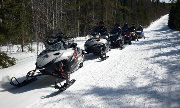 Snowmobilers on the trails near The Pas, Manitoba.
