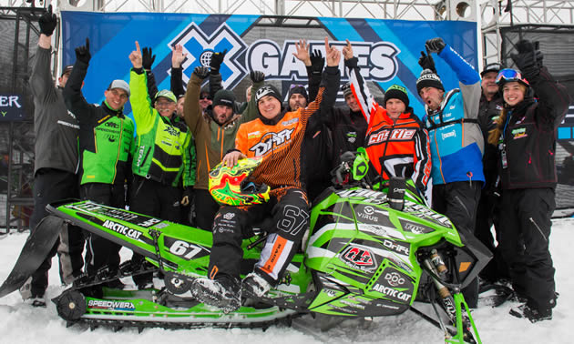 Ryan Simons and the Arctic Cat support crew on the podium at X Games.