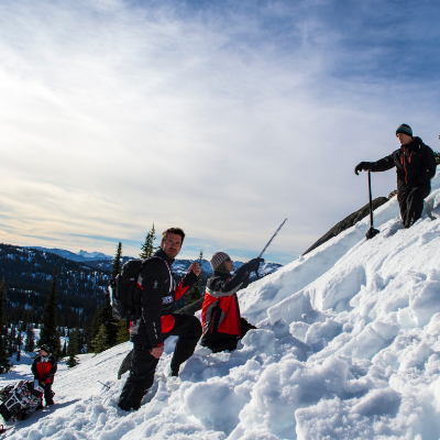 Snowmobilers check terrain for risky conditions