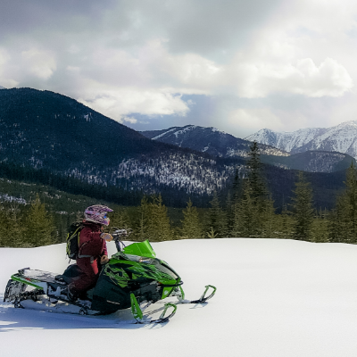 A snowmobiler looks out across the mountains in Fernie, B.C.