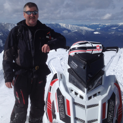 Mark Aeichele stands next to his 2016 Polaris Axys in Kuskanax Valley.