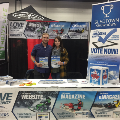 (L to R) Jason Woods, advertising consultant for SnoRiders magazine, and Samantha Ranger represented SnoRiders at our booth at the Alberta Snowmobile and Powersports Show in Edmonton, Alberta.