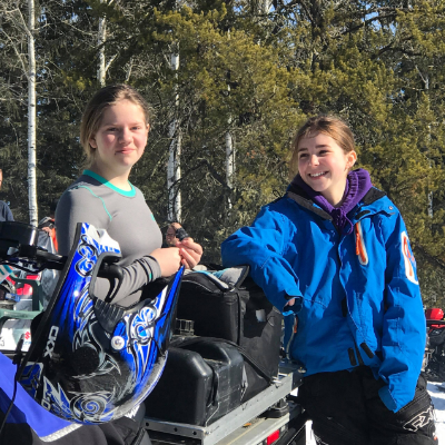 Morgan Nelson (on right) has a laugh with friend Rachael Kiland at the Barrhead Rally last winter.