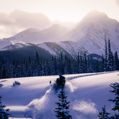 A snowmobiler enjoys riding in the Kakwa region of the North Rockies.