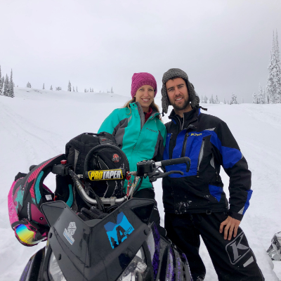Sheldon Kelly has introduced his wife Julie Kelly to snowmobiling and she, in turn, teaches him to wakesurf in the summer.