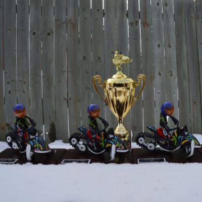 SledTown ShowDown trophies sit in the snow