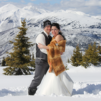 Tyler and Vicki Barrett rode snowmobiles to the top of Lucille Mountain on their wedding day for a once-in-a-lifetime photo shoot.