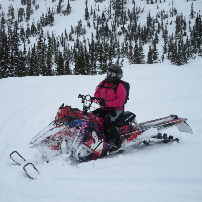 Kelsey Poelt rides a pink snowmobile on the first day of spring.