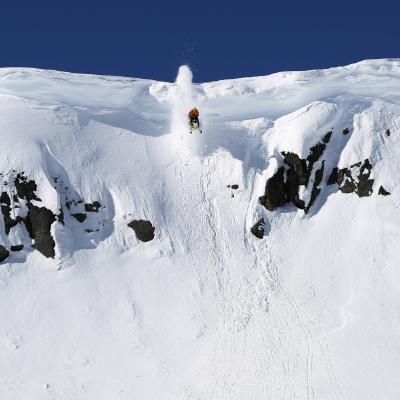 Rene St. Onge makes a 23-metre (75-foot) drop between rocks.