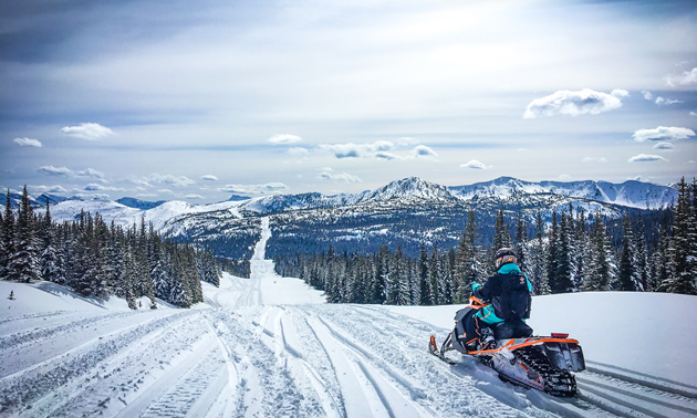 Overlooking the pipeline while snowmobiling Fernie.