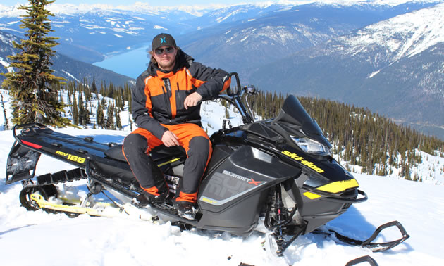 Sean Maxwell poses on his sled above Valemount.