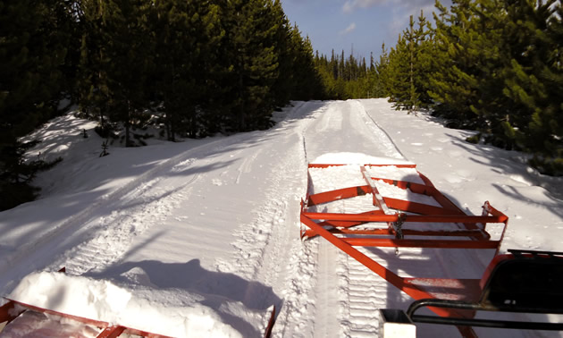 Grooming snowmobile trails in Cataract Creek