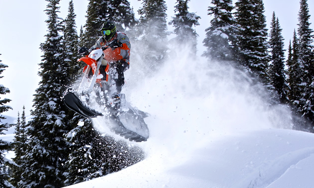 Jeff Rozzy Rosner from Team Thunderstruck takes a jump in the snow on the Yeti snow bike.