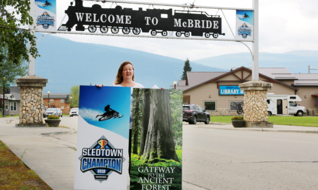 Loranne Martin, mayor of McBride, B.C., displayed signage downtown to promote the city's 2018 SledTown ShowDown victory.