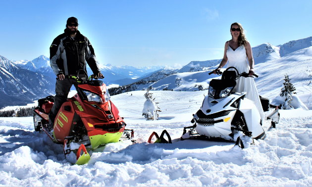 Mitch Lepage stands on a 2016 Ski-Doo Freeride and Angie stands on a 2012 Ski-Doo Freeride for their wedding at Clemina in Valemount, B.C.
